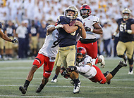 Annapolis, MD - September 23, 2017: Navy Midshipmen quarterback Zach Abey (9) gets tackled by several Cincinnati Bearcats defenders during the game between Cincinnati and Navy at  Navy-Marine Corps Memorial Stadium in Annapolis, MD.   (Photo by Elliott Brown/Media Images International)