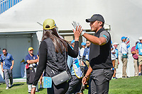 Jhonattan Vegas' (VEN) wife Hildegard Struppek gives him a high five as he departs the first tee during round 4 Singles of the 2017 President's Cup, Liberty National Golf Club, Jersey City, New Jersey, USA. 10/1/2017. <br /> Picture: Golffile | Ken Murray<br /> <br /> All photo usage must carry mandatory copyright credit (&copy; Golffile | Ken Murray)