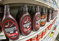 """Bottles of Hershey's chocolate syrup on a supermarket shelf in New York on Thursdya, June 30, 2016. The Hershey Co. has rejected a takeover bid from Mondelez International in the amount of $23 billion saying that there is """"no basis for further discussion."""". The Hershey Trust, which owns 80% of the voting stock, has prevented takeovers in the past including an attempt by Wm. Wrigley Jr. Co. in 2002.  (© Richard B. Levine)"""