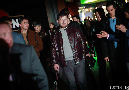 Chechen Prime Minister Ramzan Kadyrov, surrounded by body guards, attend the Millionaire Fair in Moscow. .Millionaires, billionaires and those who bought 1,000-rouble tickets were among the thousands who visited the fair held in the Crocus city expo centre. .The four-day event, held for the second year in a row, ended on October 30. The products on sale include a diamond-studded mobile phone worth a million dollars, an island, latest sports cars and other items that might appeal to the growing millionaire market..Twenty years ago, there were no official millionaires in the whole of Russia. Now Moscow has 25 billionaires and the country has 88,000 millionaires, according to Forbes Magazine. ..