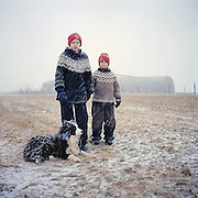 Alvin Möller, 11 y.o., Hugbjört Möller, 7 y.o., and their dog Grímur. I met their parents and did a family portrait on their farm Ytra Lón in summer 2007. Alvin was six at the time and Hugbjört about two. At the end of January 2013 I revisited Langanes peninsula and their farm, the north-easternmost farm in Iceland. The kids had grown: Hugbjört learnt to incubate and grow chickens, knit, make fried eggs and developed an interest for fashion. And Alvin now plays football and writes a book on magic rituals.