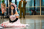 A doll-like lolita sitting at Palais des Congrès during Otakuthon Cosplay Convention.