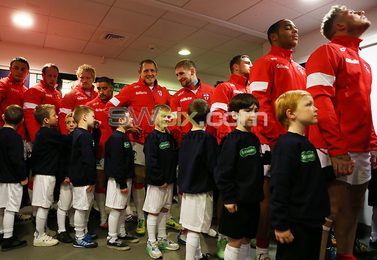 Picture by Vaughn Ridley/SWpix.com - 16/11/2013 - Rugby League - Rugby League World Cup - England v France - DW Stadium, Wigan, England - England players chat to their mascots in the tunnel prior to kickoff.