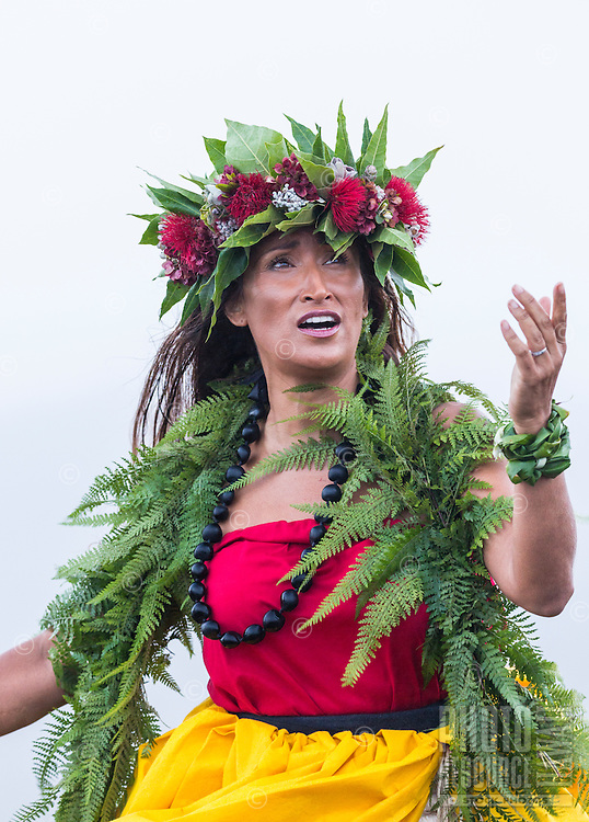 A Hawaiian cultural practitioner and dancer offers a chant at Halema'uma'u Crater in honor of the goddess Pele, Big Island of Hawai'i.