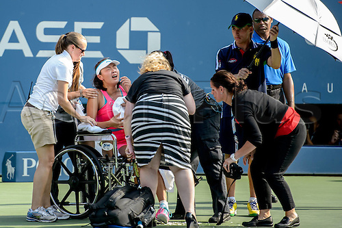 05.09.2014. Flushing Meadows, New York, USA. Shuai Peng (CHN) in a wheelchair at US Open 2014,   in the 1st womens semi-final. Wozniacki won in 2 sets as Peng retired injured