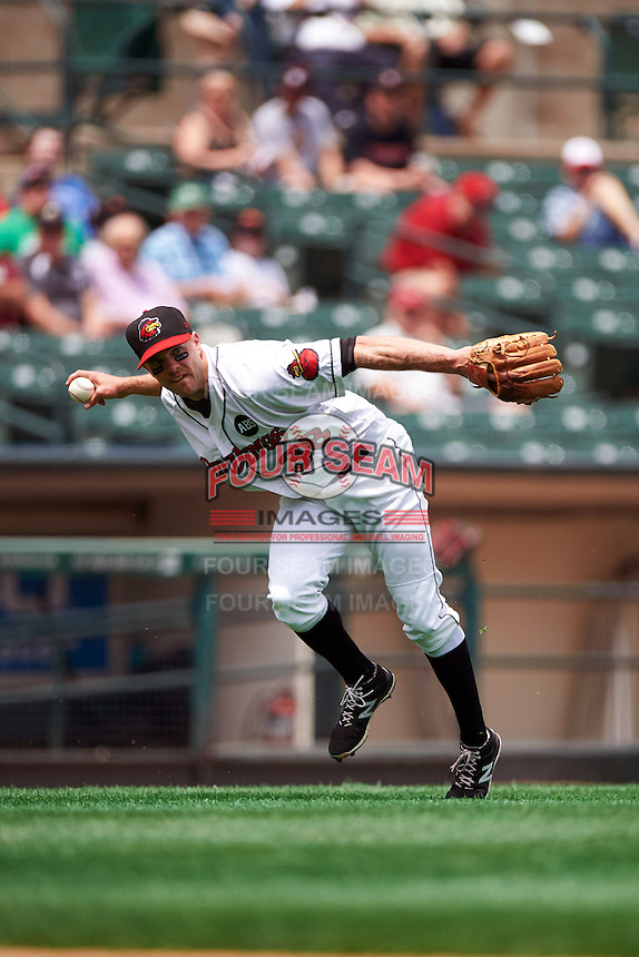 Rochester Red Wings third baseman Stephen Wickens (38) throws to first during a game against the Columbus Clippers on June 16, 2016 at Frontier Field in Rochester, New York.  Rochester defeated Columbus 6-2.  (Mike Janes/Four Seam Images)