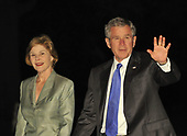Washington, D.C. - May 18, 2008 -- United States President George W. Bush and first lady Laura Bush return to the White House aboard Marine 1 after a 5 day trip to the Middle East.  During his visit The President addressed the Israeli Knesset and the World Economic Forum on the Middle East.  He also held talks in Saudi Arabia with King Abdallah on the soaring price of oil.<br /> Credit: Ron Sachs / Pool via CNP
