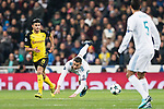 Cristiano Ronaldo of Real Madrid (R) in action against Borussia Dortmund Mahmoud Dahoud (L) during the Europe Champions League 2017-18 match between Real Madrid and Borussia Dortmund at Santiago Bernabeu Stadium on 06 December 2017 in Madrid Spain. Photo by Diego Gonzalez / Power Sport Images