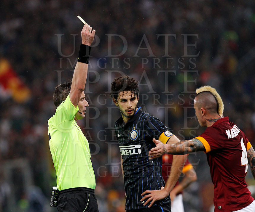 Calcio, Serie A: Roma vs Inter. Roma, stadio Olimpico, 30 novembre 2014.<br /> FC Inter&rsquo;s Andrea Ranocchia, center, argues with Roma&rsquo;s Radja Nainggolan as he is given a yellow card by referee Paolo Mazzoleni during the Italian Serie A football match between AS Roma and FC Inter at Rome's Olympic stadium, 30 November 2014.<br /> UPDATE IMAGES PRESS/Riccardo De Luca