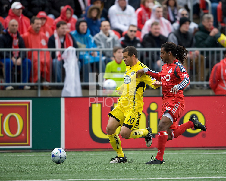2 May 2009: Columbus Crew forward Alejandro Moreno # 10 and Toronto FC defender Adrian Serioux #15 in action at BMO Field in Toronto in a  game between the Columbus Crew and Toronto FC..The game ended in a 1-1 draw.