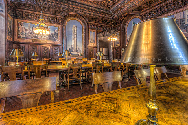 Beautiful wood paneling and murals provide a wonderful surrounding for the brass lamp equipped reading tables in the New York Public Library's DeWitt Wallace Periodicals Room.  The Periodicals Room is located in the Stephen A. Schwarzman Building on 5th Avenue and 42nd Street in New York City.