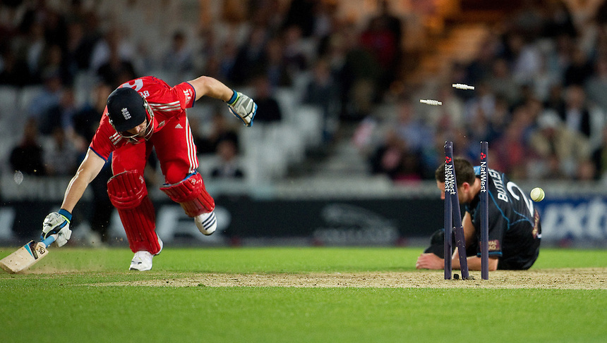 England's Jos Buttler run out in the T20 game at the Oval against New Zealand<br /> <br />  (Photo by Ashley Western/CameraSport) <br /> <br /> International Cricket - NatWest International T20 Series - England v New  Zealand - Tuesday 25th June 2013 - The Kia Oval, London <br /> <br />  &copy; CameraSport - 43 Linden Ave. Countesthorpe. Leicester. England. LE8 5PG - Tel: +44 (0) 116 277 4147 - admin@camerasport.com - www.camerasport.com