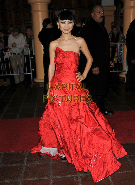 BAI LING .at The Santa Barbara Film Festival, at The Arlington Theatre in Santa Barbara, California, USA, January 23th 2009                                                                     .full length strapless red dress long maxi gown hand on hip diamante straps halterneck .CAP/DVS.©Debbie VanStory/Capital Pictures