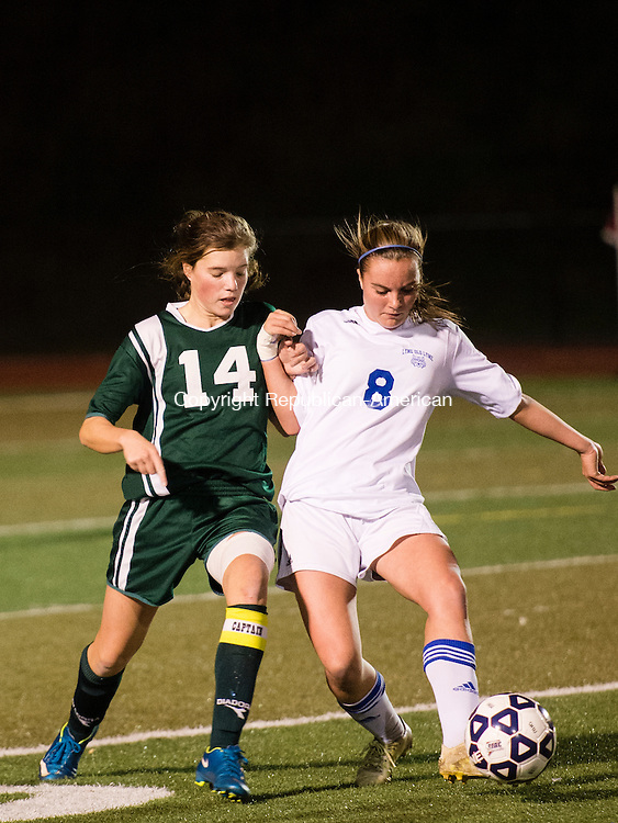MIDDLETOWN, CT - 16 November 2015-111615EC08-- Holy Cross' Taylor Gilmore and Old Lyme's Mary Bolles jostle for the ball in Middletown Monday night. Erin Covey Republican-American.