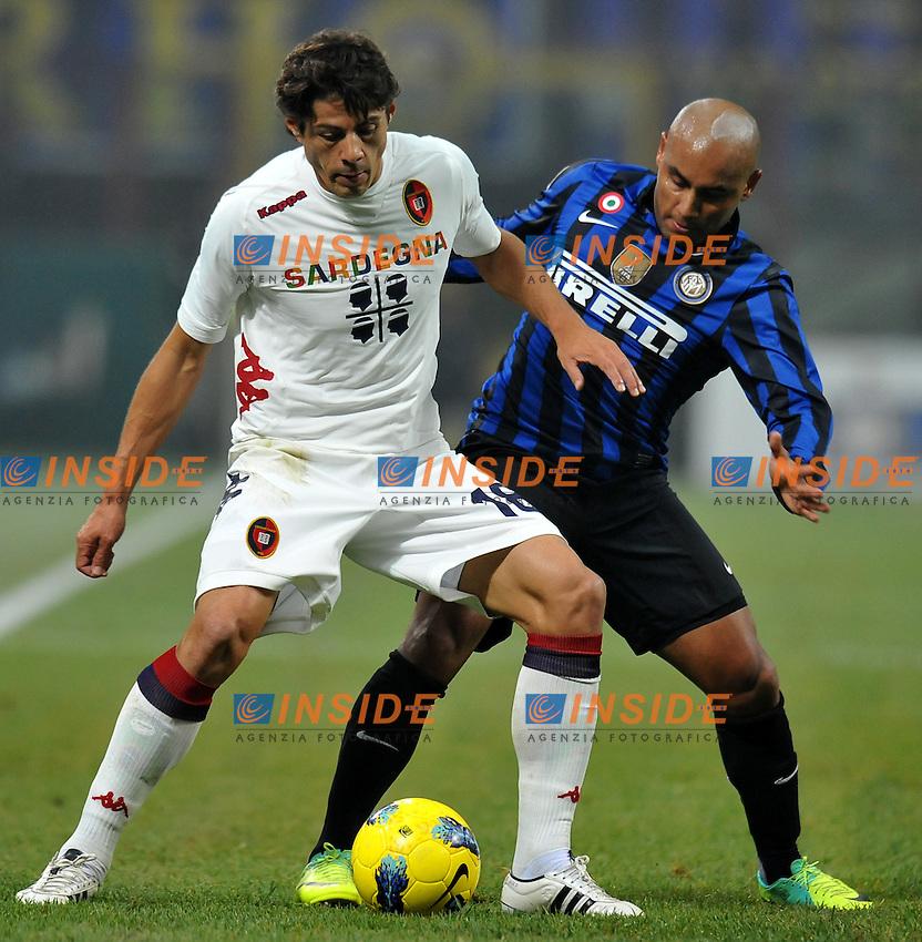 """JONATHAN (Inter), NENE (Cagliari).Milano 19/11/2011 Stadio """"Giuseppe Meazza"""".Serie A 2011/2012.Football Calcio Inter Vs Cagliari.Foto Insidefoto Alessandro Sabattini."""