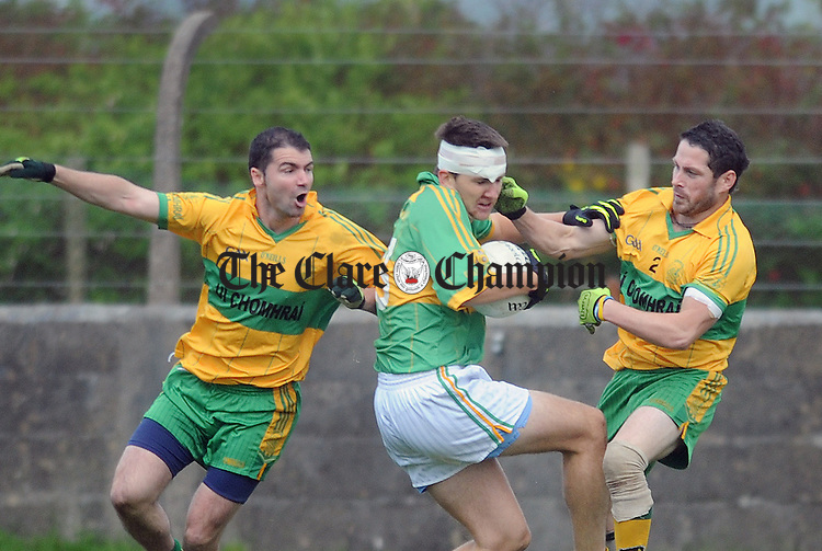 Brian Troy and Paul Roche of O' Curry's put pressure on Niall Pender. Photograph by Declan Monaghan