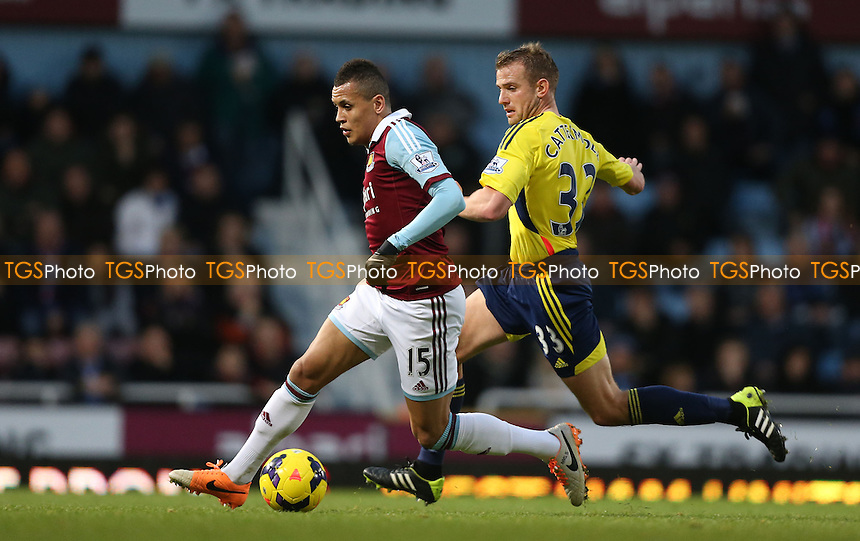 Ravel Morrison of West Ham and Lee Cattermole of Sunderland - West Ham United vs Sunderland, Barclays Premier League at Upton Park, West Ham - 14/12/13 - MANDATORY CREDIT: Rob Newell/TGSPHOTO - Self billing applies where appropriate - 0845 094 6026 - contact@tgsphoto.co.uk - NO UNPAID USE