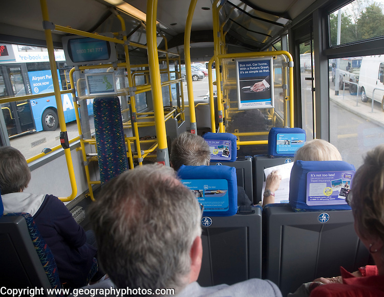Passengers travelling on Airparks airport parking shuttle bus Gatwick airport, London, England