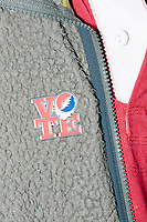 A man from the organizatoin HeadCount wears a Grateful Dead-inspired Vote pin after Democratic presidential candidate Senator Kirsten Gillibrand (D-NY) speaks at a town hall campaign event at the Concord Parks and Recreation Community Center in Concord, New Hampshire, USA on Sat., Apr. 6, 2019. HeadCount is a non-partisan organization that registers people to vote at concerts around the US.