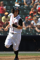 Richmond Flying Squirrels center fielder Gary Brown #14 crossing home plate after scoring a run during a game against the Trenton Thunder at The Diamond on May 27, 2012 in Richmond, Virginia. Richmond defeated Trenton by the score of 5-2. (Robert Gurganus/Four Seam Images)