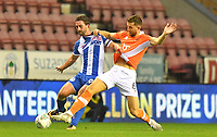 Blackpool's Will Aimson battles with Wigan Athletic's Will Grigg<br /> <br /> Photographer Dave Howarth/CameraSport<br /> <br /> The Carabao Cup - Wigan Athletic v Blackpool - Tuesday 8th August 2017 - DW Stadium - Wigan<br />  <br /> World Copyright &copy; 2017 CameraSport. All rights reserved. 43 Linden Ave. Countesthorpe. Leicester. England. LE8 5PG - Tel: +44 (0) 116 277 4147 - admin@camerasport.com - www.camerasport.com