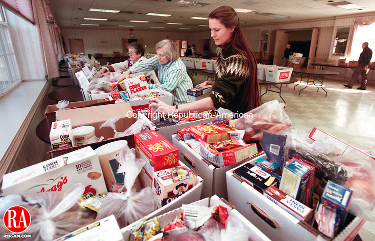 SOUTHBURY, CT 11/23/98--1123TK02.tif  (left to right:)Members of the Southbury Food Bank, Ellie Rose, Angela Harkness and Leslie Hine, President of the Soutbury Food Bank, packed Thanksgiving food baskets at the Southbury firehouse for distribution to 75 needy families. The conducted food drive for needy residents was conducted by local Boy Scouts, Chruch groups and town businesses. --TOM KABELKA staff photo for Chris Gardner story.  (Filed in Scans/Scan-In)