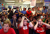 May 27, 2009. Chapel Hill, NC..People line the chairs and stand through Italian Pizzeria to watch the Barcelona vs. Manchester soccer game on two large screen TVs. Barcelona took the win at 2-0.