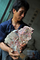 Mr Yang, manager from the Yun Chang Ping mercury mine holds a piece of mercury mined from deep with-in the mountains about 30