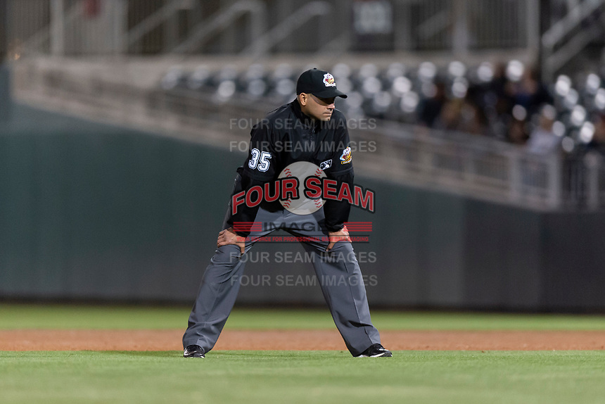 Umpire Roberto Ortiz during a Pacific Coast League game between the El Paso Chihuahuas and Albuquerque Isotopes at Southwest University Park on May 10, 2019 in El Paso, Texas. Albuquerque defeated El Paso 2-1. (Zachary Lucy/Four Seam Images)