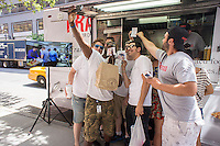"""Bros"" do a ""selfie"" to post on social media in front of the Frankenfood truck in the Hudson Square neighborhood of New York on Friday, June 20, 2014.  (© Richard B. Levine)"