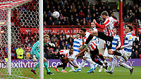 Ollie Watkins scores Brentford's third goal during Brentford v Queens Park Rangers, Sky Bet EFL Championship Football at Griffin Park on 11th January 2020