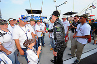 Driver Kurt Busch greets a group of the grid.