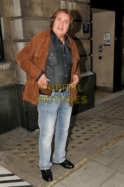Engelbert Humperdinck leaving BBC Radio 2, London, England..17th October 2011.full length jeans denim mobile phone holster belt jeans denim black shirt brown suede jacket.CAP/IA.©Ian Allis/Capital Pictures.