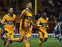 Motherwell's Keith Lasley (14) is congratulated by team mates after he scores Motherwell's third goal...