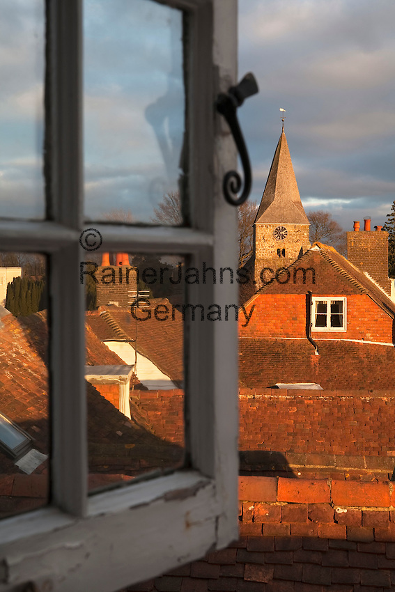 United Kingdom, England, East Sussex, Burwash: view through open window over rooftops of Burwash village