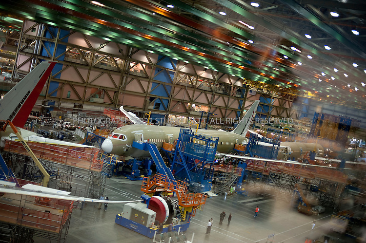 4/30/2009--Everett, WA, USA..At Boeing's Everett, Wash., the first Boeing 787s are under production. Boeing expects the first test flight for the aircraft in the second quarter of 2009...The 787-8 Dreamliner will carry 210 - 250 passengers on routes of 7,650 to 8,200 nautical miles (14,200 to 15,200 kilometers), while the 787-9 Dreamliner will carry 250 - 290 passengers on routes of 8,000 to 8,500 nautical miles (14,800 to 15,750 kilometers).  A third 787 family member, the 787-3 Dreamliner, will accommodate 290 - 330 passengers and be optimized for routes of 2,500 to 3,050 nautical miles (4,600 to 5,650 kilometers). ..In addition to bringing big-jet ranges to mid-size airplanes, the 787 will provide airlines with unmatched fuel efficiency, resulting in exceptional environmental performance. The airplane will use 20 percent less fuel for comparable missions than today's similarly sized airplane. It will also travel at speeds similar to today's fastest wide bodies, Mach 0.85. Airlines will enjoy more cargo revenue capacity. Passengers will also see improvements with the new air..Photograph ©2009 Stuart Isett.All rights reserved