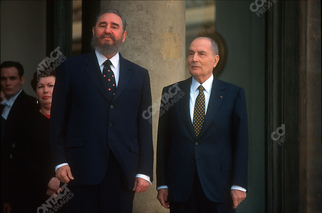 Fidel Castro, (left) President of Cuba, with French President Francois Mitterrand during an official visit. Paris, France, March 1995<br />
