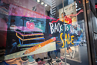 A Back-to-School sale advertisement in the window of a Skechers store in Times Square in New York on Friday, August 5, 2016. Skechers stock hit a 52 week low after its second quarter missed analysts' expectations.   (© Richard B. Levine)
