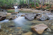 "The Baby Flume in Franconia Notch State Park of Lincoln, New Hampshire USA during the spring months. This natural feature is located on the Pemigewasset River just below the ""The Basin"" viewing area."
