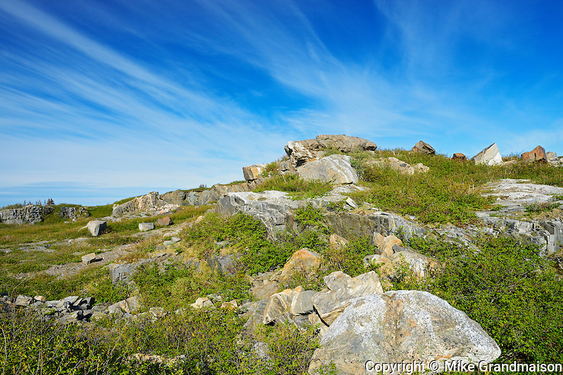 Rocky, barren landscape and clouds<br />