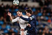 23rd November 2019; Estadio Santiago Bernabeu, Madrid, Spain; La Liga Football, Real Madrid versus Real Sociedad; Daniel Carvajal (Real Madrid)  wins the header from Mikel Oyarzabal (Real Sociedad) who receives a shoulder in the face