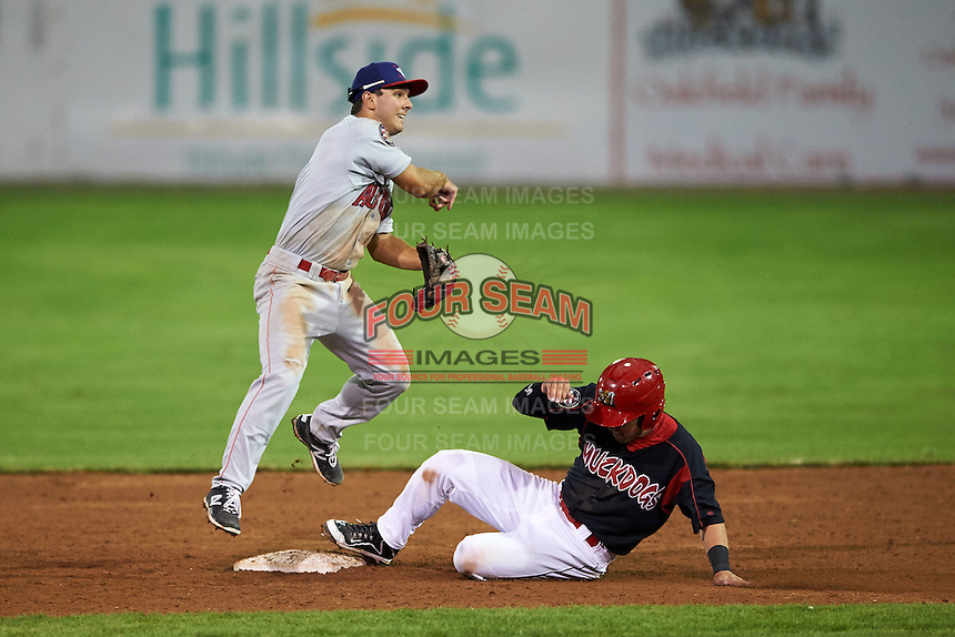Auburn Doubledays second baseman Max Schrock (9) throws to first as Joseph Chavez slides in during a game against the Batavia Muckdogs on July 10, 2015 at Dwyer Stadium in Batavia, New York.  Auburn defeated Batavia 13-1.  (Mike Janes/Four Seam Images)