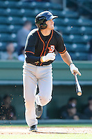 Infielder Joel Hutter (12) of the Delmarva Shorebirds bats in a game against the Greenville Drive on Monday, April 29, 2013, at Fluor Field at the West End in Greenville, South Carolina. Delmarva won, 6-5. (Tom Priddy/Four Seam Images)