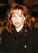 Paula Jones walks to a press conference called by Abe Hirschfeld where she received a check for one million dollars to settle her sexual harassment lawsuit against United States President Bill Clinton at the Mayflower Hotel in Washington, DC on 31 October, 1998.<br /> Credit: Ron Sachs / CNP