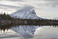 Sukakpak mountain of the Brooks Range reflect in the calm waters of a tundra pond, Arctic, Alaska