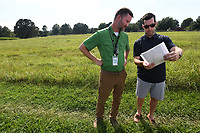 NWA Democrat-Gazette/J.T. WAMPLER Byron Humphries, Fayetteville Parks Department maintenance supervisor (LEFT) and Richie Lamb, chair of the Fayetteville Parks and Recreation Advisory Board look at plans while members of the board take a tour of a piece of land adjacent to Gulley Park Monday August 5, 2019. The land is part of a proposed subdivision development. If accepted, the land would expand Gulley Park by about an acre.