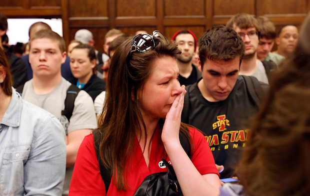An Iowa State University student weeps alongside fellow students upon the announcement of the suspension of VEISHEA Wednesday on the campus of Iowa State Univerity in Ames.  Moments later, the distraught student left the packed Memorial Union room before president Leath finished his remarks.