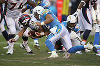 11/27/11 San Diego, CA: Denver Broncos quarterback Tim Tebow #15 and San Diego Chargers free safety Eric Weddle #32 during an NFL game played between the Denver Broncos and the San Diego Chargers at Qualcomm Stadium. The Broncos defeated the Chargers 16-13 in OT