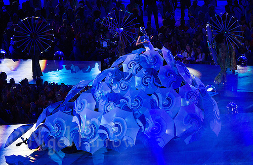 "12 AUG 2012 - LONDON, GBR - Marisa Monte dressed as the Brazilian water goddess Yemanja sings during the ""Embrace"" section, which was designed to introduce people to Rio de Janiero the next hosts of the Summer Olympic Games in 2016, during  the London 2012 Olympic Games Closing Ceremony in the Olympic Stadium in the Olympic Park, Stratford, London, Great Britain .(PHOTO (C) 2012 NIGEL FARROW)"