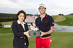 Midori Miyazaki from ISPS Handa presents the trophy to 2013 ISPS Handa Wales Open champion Gregory Bourdy <br /> Celtic Manor Resort<br /> <br /> 01.09.13<br /> <br /> ©Steve Pope-Sportingwales